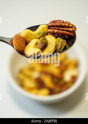 Mixed nuts, almond, pecan, pistachio, cashew. - Stock Photo