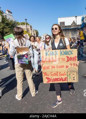 London / UK - September 20th 2019 - Extinction rebellion climate change activist holds a sign outside Parliament in Westminster - Stock Photo