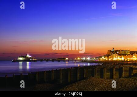 Eastbourne Pier during the evening in the winter. - Stock Photo