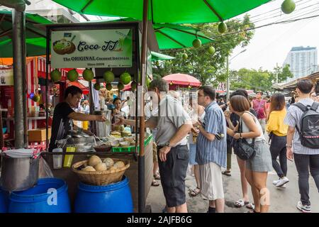 Bangkok,Thailand - November 2,2019 : People can seen quieing to buy coconut ice cream at stall in Chatuchak weekend market. - Stock Photo