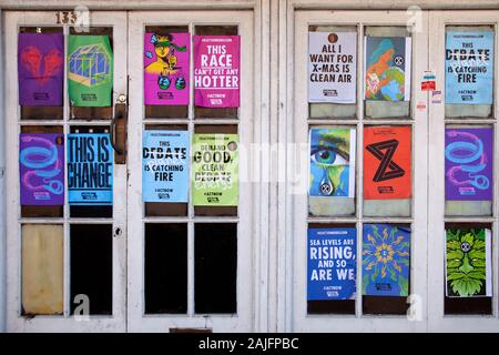 Extinction Rebellion Posters on Vacant Property Facade in London, Wandsworth, UK - Stock Photo