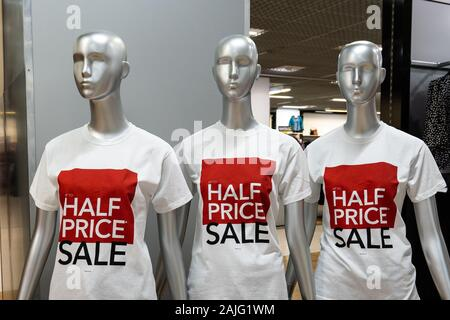 Mannequin's in the Debenhams department store, clothing shop advertising a half price sale, post Christmas and New Year sales