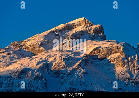 First sun light at the snow-covered Piz da Lec de Boe, Sella mountain range, Dolomites, South Tyrol, Italy - Stock Photo