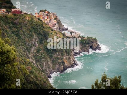 Manarola, Cinque Terre (Five Lands), Liguria, Italy: Aerial view of a village perched on a hill, typical colorful houses. UNESCO World Heritage Site - Stock Photo