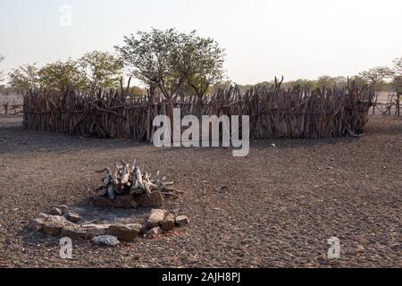 Himba Village - Traditional Fireplace for the Sacred Ancestral Fire and Cattle Enclosure near Opuwo, Namibia - Stock Photo