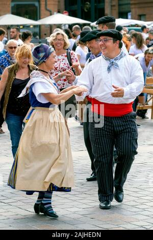 Folk dancers in traditional costumes, Place du Capitole Square, Toulouse, Haute-Garonne, France, Europe - Stock Photo