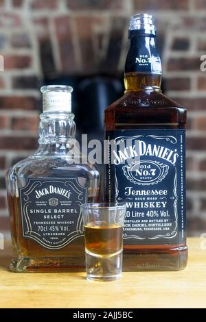Shot of whiskey next to a Bottle of Jack Daniels Single Barrel Select and Old No. 7 - Stock Photo