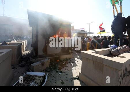 Beijing, Iraq. 31st Dec, 2019. Protesters gather in front of the U.S. embassy in Baghdad, Iraq, on Dec. 31, 2019. Credit: Khalil Dawood/Xinhua/Alamy Live News - Stock Photo