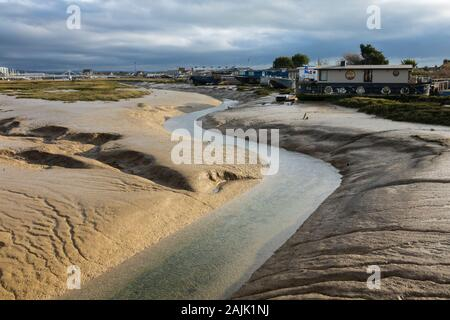 Houseboats on the mudflats at low tide, Shoreham-by-Sea; West Sussex; England, United Kingdom, Europe - Stock Photo