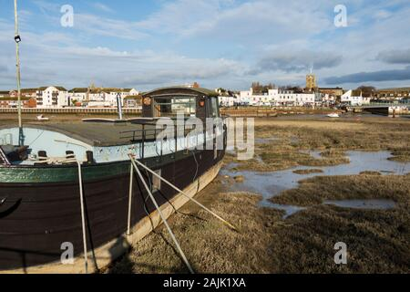 Houseboat moored on mudflats of the River Adur, Shoreham-by-Sea; West Sussex; England, United Kingdom, Europe - Stock Photo