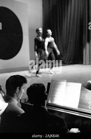 John Cage and David Tudor in performance in New York City, 1957, probably performing Winter Music. The exact date and venue are unknown. - Stock Photo