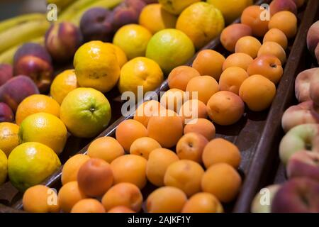 Mixed coloured fresh seasonal fruit at the market mall - consumerism and shopping business concept - vitamins and healthy food lifestyle concept - Stock Photo
