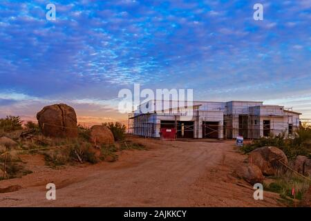 Sunset time at a new home construction site in North Scottsdale, Arizona. - Stock Photo