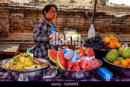 Mandalay, Myanmar - Feb 22, 2016. A vendor selling fresh fruits near Mingun Pahtodawgyi in Mandalay, Myanmar. - Stock Photo