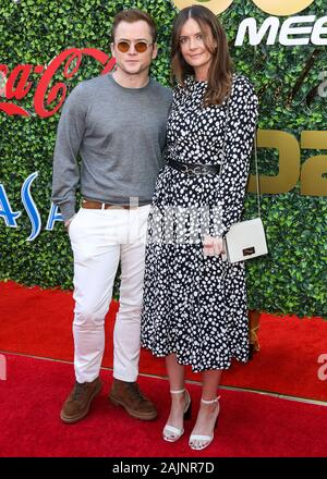 Beverly Hills, USA. 04th Jan, 2020. BEVERLY HILLS, LOS ANGELES, CALIFORNIA, USA - JANUARY 04: Taron Egerton and Emily Thomas arrive at the 7th Annual Gold Meets Golden Event held at Virginia Robinson Gardens and Estate on January 4, 2020 in Beverly Hills, Los Angeles, California, USA. (Photo by Xavier Collin/Image Press Agency) Credit: Image Press Agency/Alamy Live News
