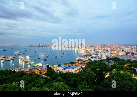 High view on viewpoint see cityscape with colorful light at the beach and the sea of Pattaya Bay, beautiful landscape of Pattaya City at sunset landma