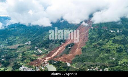 (200105) -- BEIJING, Jan. 5, 2020 (Xinhua) -- Aerial photo taken on July 26, 2019 shows a landslide site in Pingdi Village of Jichang Town in Shuicheng County, southwest China's Guizhou Province. (Xinhua/Tao Liang) - Stock Photo