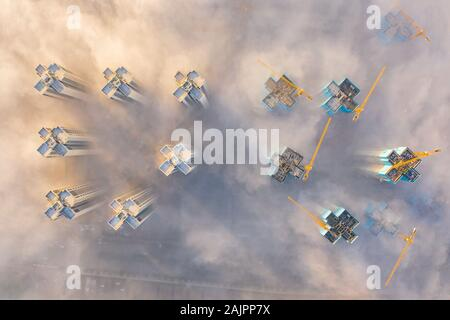 (200105) -- BEIJING, Jan. 5, 2020 (Xinhua) -- Aerial photo taken on Dec. 6, 2019 shows fog shrouding buildings in downtown Guiyang City, southwest China's Guizhou Province. (Xinhua/Liu Xu) - Stock Photo