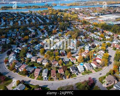 Montreal, Quebec, Canada, aerial view of family homes in typical residential neighbourhood during fall season. - Stock Photo