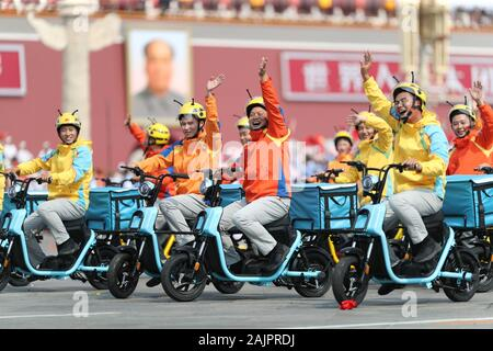 (200105) -- BEIJING, Jan. 5, 2020 (Xinhua) -- People take part in a mass pageantry celebrating the 70th anniversary of the founding of the People's Republic of China in Beijing, capital of China, Oct. 1, 2019. (Xinhua/Ou Dongqu) - Stock Photo