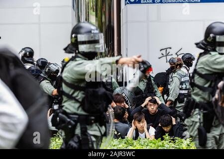 Hong Kong, China. 05th Jan, 2020. Police in riot gear rounding up suspected protesters during the demonstration.Entering the 7th month of civil unrest, protesters marched the streets, protesting against Chinese parallel traders. Demonstrators chanted slogans and sang songs. Police in riot gear appeared and arrested several protesters. Credit: SOPA Images Limited/Alamy Live News - Stock Photo