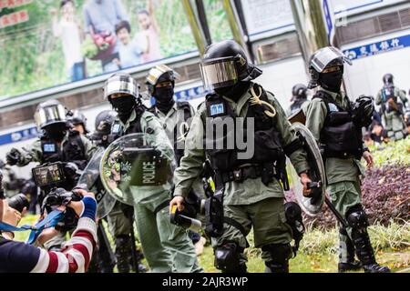 Hong Kong, China. 05th Jan, 2020. Police in riot gear during the demonstration.Entering the 7th month of civil unrest, protesters marched the streets, protesting against Chinese parallel traders. Demonstrators chanted slogans and sang songs. Police in riot gear appeared and arrested several protesters. Credit: SOPA Images Limited/Alamy Live News - Stock Photo