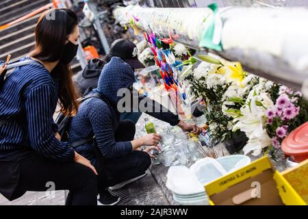 Hong Kong, China. 05th Jan, 2020. Protesters light candles at the makeshift shrine during the demonstration.Entering the 7th month of civil unrest, protesters marched the streets, protesting against Chinese parallel traders. Demonstrators chanted slogans and sang songs. Police in riot gear appeared and arrested several protesters. Credit: SOPA Images Limited/Alamy Live News - Stock Photo