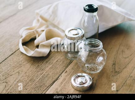Cloth bag and glass jars on wooden table, no plastic packages, zero waste concept