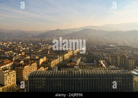 Rooftops view of the historic centre of Turin and its hills from the top of Mole Antonelliana with Palazzo Nuovo university building, Piedmont, Italy - Stock Photo