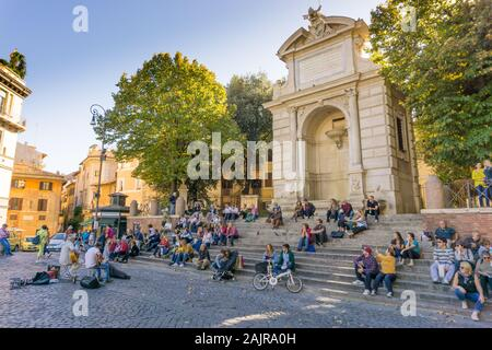 ROME, ITALY - OCTOBER 10, 2017: people are listening to an outdoor concert in Trilussa Square in Trastevere district in Rome, Italy