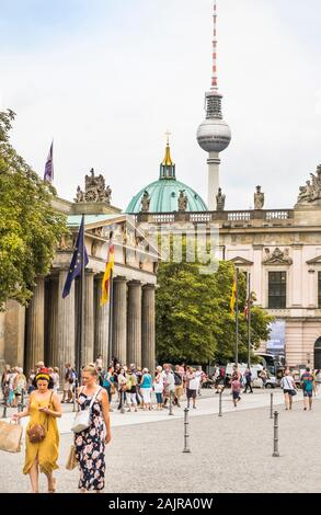 street scene in front of neue wache, new gardhouse, berlin cathedral and television tower in background - Stock Photo