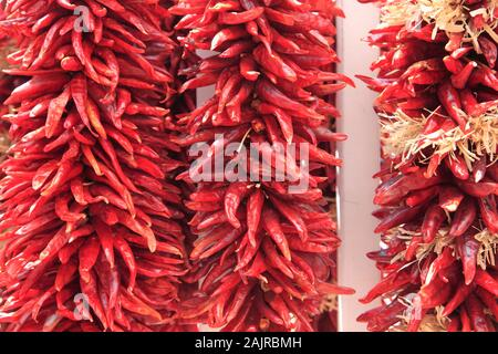 Dried red chillies, Chili Ristras, Santa Fe, New Mexico, USA - Stock Photo