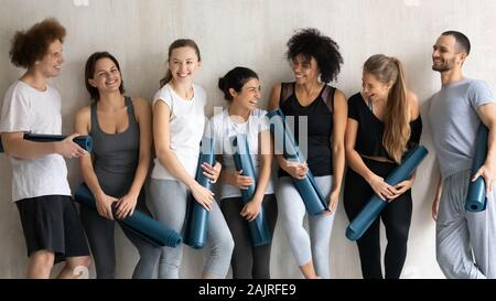 Happy diverse people having fun in studio after yoga training - Stock Photo