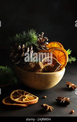 Concept of Christmas. Closeup of Christmas compositions with dried orange slices, cinnamon and anise on white background. Stock Photo