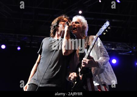 Milan Italy, 08 July 2012, live concert of Ray Manzarek and Robby Krieger of The Doors , at the 'Ippodromo del Galoppo': Robby Krieger and the singer Dave Brock during the concert - Stock Photo