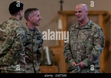 Pope Army Airfield, NC, USA. 5th Jan, 2020. Jan. 5, 2020 - POPE ARMY AIRFIELD, N.C., USA - Maj. Gen. James J. Mingus, right, commander of the the U.S. ArmyÃs 82nd Airborne Division, talks with paratroopers who continue their deployment from Pope Army Airfield, North Carolina. The 'All American Division' Immediate Response Force (IRF), based at Fort Bragg, N.C., mobilized for deployment to the U.S. Central Command area of operations in response to increased threat levels against U.S. personnel and facilities in the area. TodayÃs deployment follows the Jan. 1 deployment of a division infan - Stock Photo