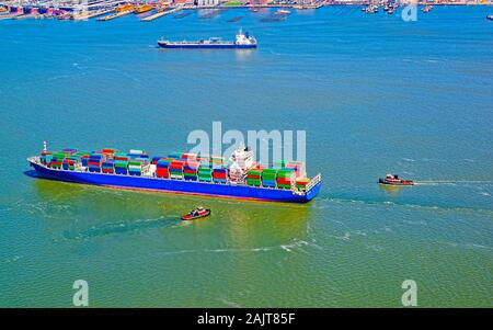 Container ship and Staten Island ferry terminal reflex - Stock Photo