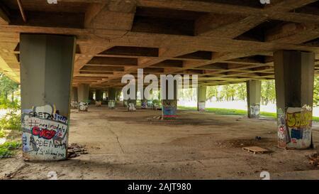 Walking under Zagreb`s old, graffiti sprayed bridges - Stock Photo