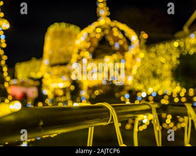Festive crown defocused blurry bokeh in background illumination Trsat fort in Rijeka Croatia isolated metal fence in foreground - Stock Photo