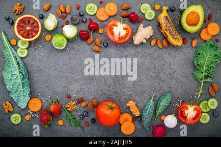Various fruits and vegetables for healthy smoothies  on dark stone background with copy space. - Stock Photo