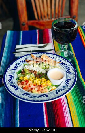 mexican salad with corn, pepper, chips, cheese, avocado and sauce - Stock Photo