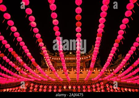 Red lanterns hanging in rows during chinese lunar new year in the night at Thean Hou Temple, Kuala Lumpur, Malaysia