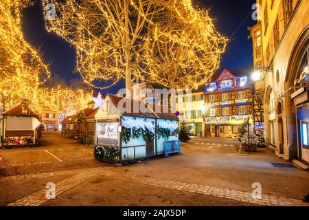 Colmar, France - November 23 2019: Streets of the Old town of Colmar, Alsace, illuminated for Christmas celebrations. Christmas market in Colmar is on - Stock Photo