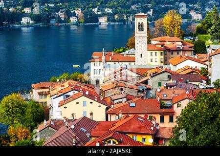 Lake Como, Lombardy, Italy, view over the red tiled roofs of the picturesque village of Torno. Lake Como is a popular travel destination near Milan. - Stock Photo