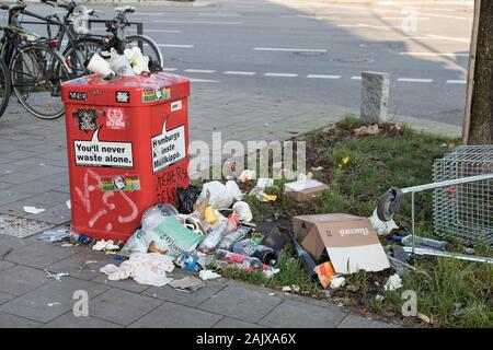 Garbage can full of trash on NewYear'sDay - Stock Photo