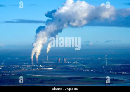 Polluting smoke drifting south in winter sun, from Fiddlers Ferry Coal Power Station, Merseyside, North West England, UK