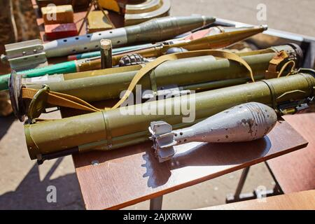 A mortar mine and a hand grenade launcher at the stand. Weapons of war in Ukraine - Stock Photo