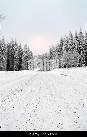 Beautiful winter landscape with a dangerous and slippery snow-covered mountain road - Stock Photo