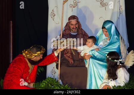 Reenactment of the christmas nativity scene with real people in Funchal city, Madeira island, Portugal - Stock Photo