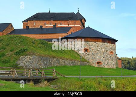 Medieval fortress on coast of lake Vanajavesi in old Hameenlinna, Finland - Stock Photo